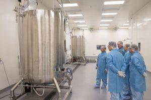 President Sukeno touring FDB's Saturn mAb manfacturing facility